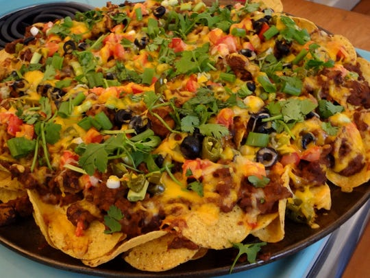 Making your own nachos at home is the best way to get everything you want in one dish.