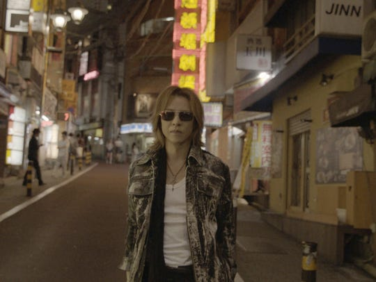 Yoshiki walks along a quiet street in Japan in Drafthouse