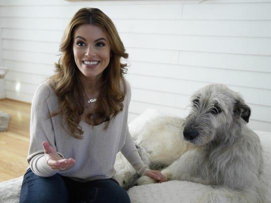Kate Banaszak with her dog, Kellan, at her home in