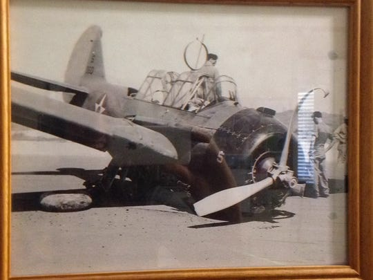 Historic photos of Michael Siconolfi and his fighter plane during WWII.