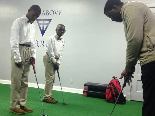 Scholars at Valiant Cross Academy learn golf from coach