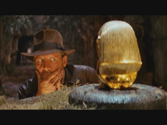 Archaeologist Indiana Jones tries to figure out how