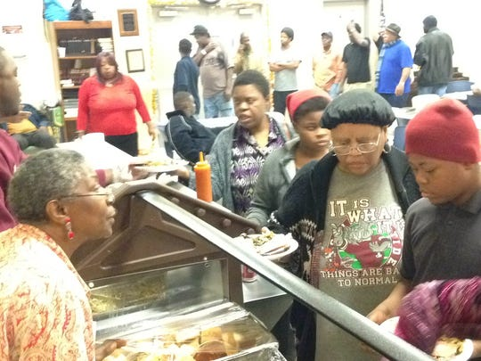 Dozens were given a free Christmas meal at Friendship Mission on Mobile Highway after a service on Sunday.