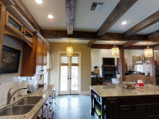 The kitchen is large with all modern amenities.
