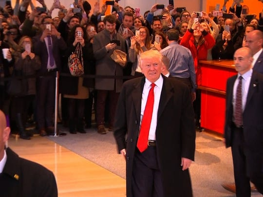 Former Battle Creek police officer Jeff Armstrong, foreground, was part of the Secret Service detail when Republican Presidential Candidate Donald Trump visited the offices of the New York Times on Nov. 22.
