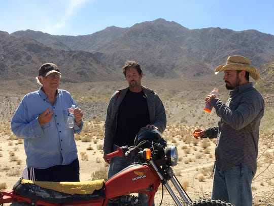 """Director of """"Do it or Die"""" Jorn Winther (on left) talks to lead actor Andrew McGuinness (on far right) and his stunt double during a film shoot in the La Quinta cove."""