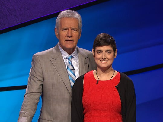 "In this photo provided by Jeopardy Productions Inc., Cindy Stowell, right, appears on the ""Jeopardy!"" set with Alex Trebek in Culver City, Calif."