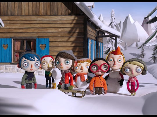 "The cast of ""My Life as a Zucchini"" stands in the snow during a cabin trip."