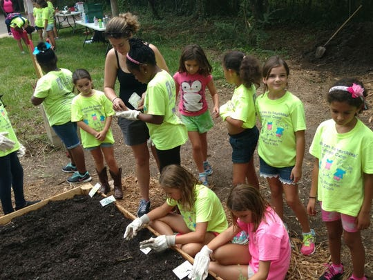 Frenchtown Heritage Hub installed its Living Classroom at the Frenchtown Farmers Market in August 2016. The raised garden beds were installed Tuesday with the help of campers from Oasis Center for Women & Girls.