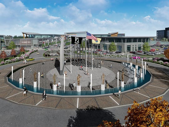 Rendering of Freedom Pointe, a mixed-use development planned for the Eatontown side of Fort Monmouth. Rendering shows monuments and flags dedicated to the fort's military past.