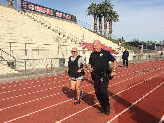 Palm Springs Police Officer Joe Cook and his wife, Colleen, participate in a run to honor fallen law enforcement officers. Cook planned to jog 50 miles around the Palm Springs High School track.