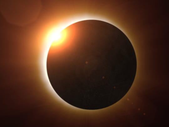 A total solar eclipse moments before totality
