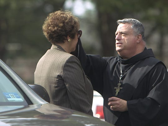 3/1/17: Father Anthony Lipari of The Good Shepherd American National Catholic Church in Toms River, administers ashes in the parking lot.