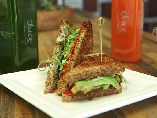 The menu at The Juice Theory includes the Veganwich, a sandwich made with pesto spread, roasted red peppers, zucchini, avocado and sprouts.