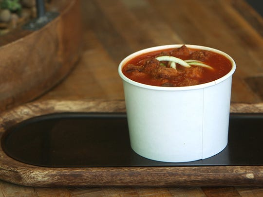 The menu at The Juice Theory includes tomato Soup with raw zucchini and garlic croutons.