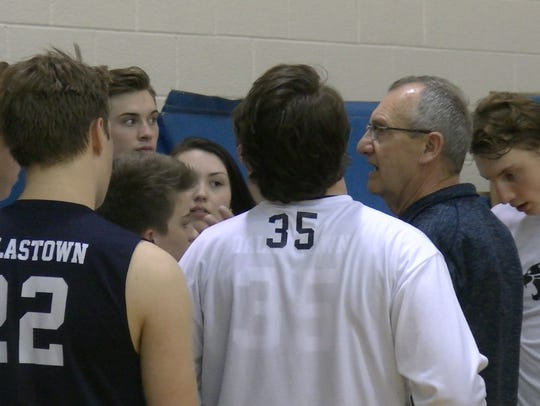 Tom Beakler, right, talks to Dallastown players after