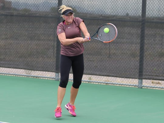 New Mexico State's Lindsay Harlas returns a shot Saturday during the Western Athletic Conference Tennis Tournament at the NMSU Tennis Center.