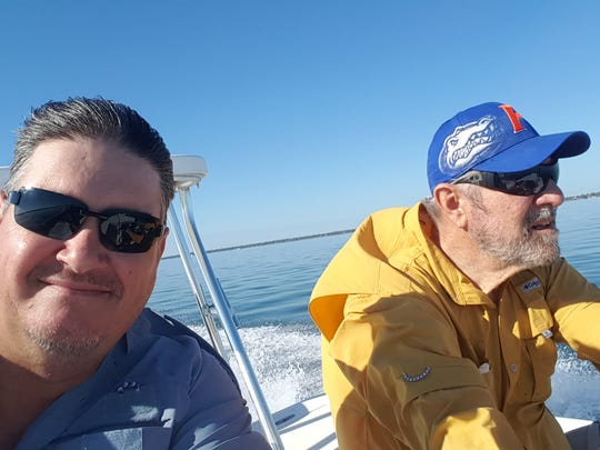 Two guys, columnist Ed Killer, (left), and Donn Bearman, of Port St. Lucie, go fishing.