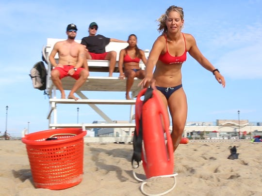 Lifeguard Julianna Cavano in action. Asbury Park lifeguards train on the beach they protect during the day. Asbury Park, NJ Friday, August 12, 2016 @dhoodhood