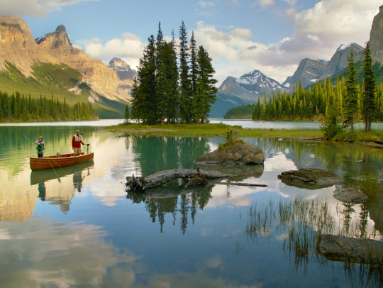 A father and son fishing on Maligne Lake in Jasper