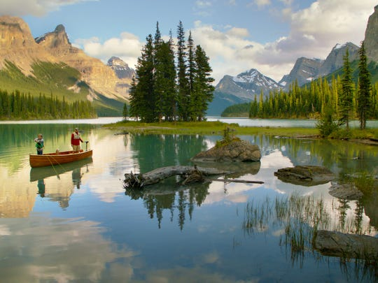 A father and son fishing on Maligne Lake in Jasper National Park