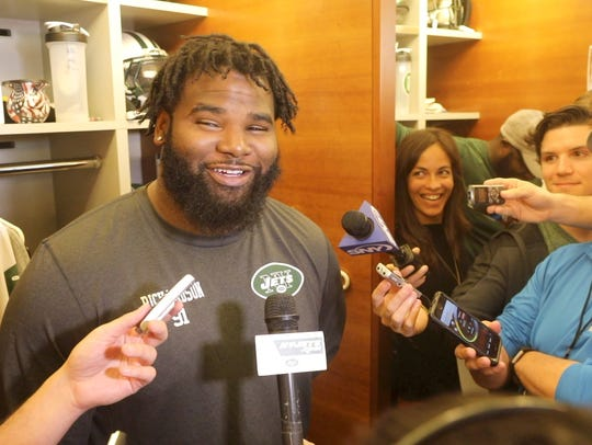 Sheldon Richardson of the Jets talks in front of his