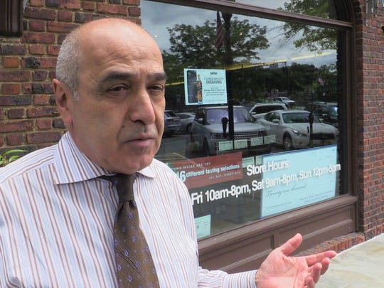 Alex Javadi talks about the Freightway parking garage and lot near the Scarsdale Metro-North railroad station, June 7, 2017