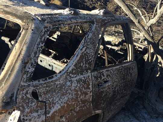 This car is seen destroyed in the Manzanita Fire. It's in a charred area on the west side of Highway 79.