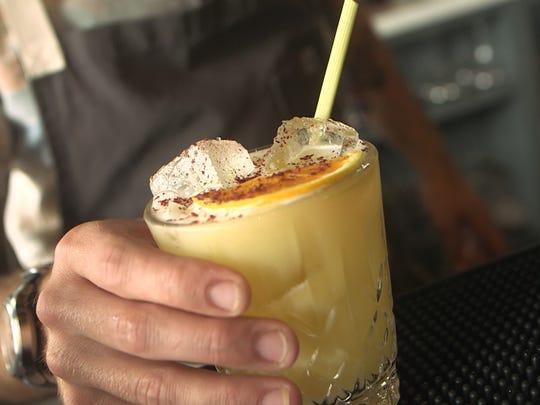 Bartender John Peet serves creates original cocktail