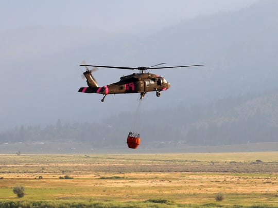 Helicopter carrying water drop to Brenda fire in Washoe Valley on Friday, July 14, 2017.