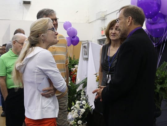 Michael Stern, the father of Sarah, right, talks with