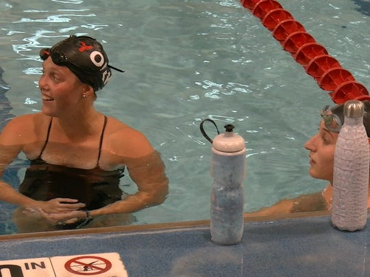 Leah Braswell, left, and University of Tennessee swimmer Meghan Small pause during a training session with the York YMCA Aquatic Club at Graham Aquatic Center in York.