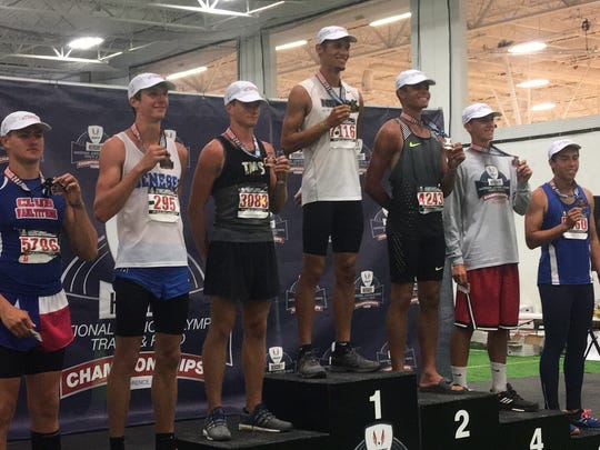 JJ Ply on top of the medal stand at the Junior Olympic