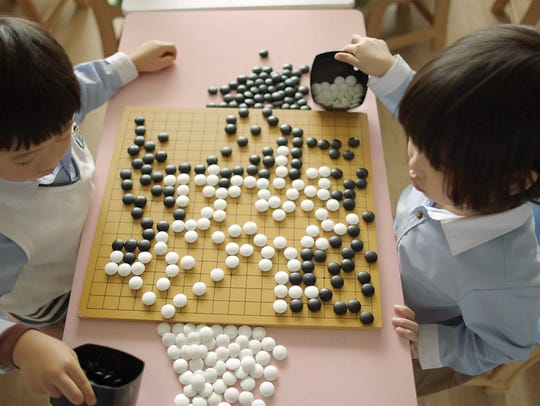 "The documentary ""AlphaGo"" follows a competition between"