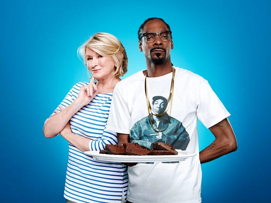 """Lifestyle maven Martha Stewart and American rapper Snoop Dogg pose in a promotional photo for their VH1 series, """"Martha & Snoop's Potluck Dinner Party."""" The show's second season will premiere Oct. 16."""