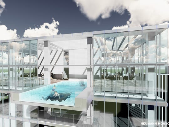 This is a rendering of The Blackbird's marquee cantilevered pool. The pool will sit atop the 33-story apartment tower, which is expected to open in December 2019.