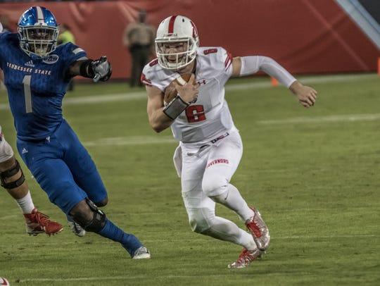 Austin Peay quarterback Jeremiah Oatsvall rushes against