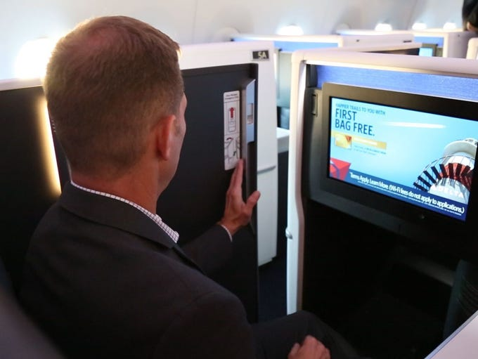 A passenger closes a privacy door on Delta's new Delta