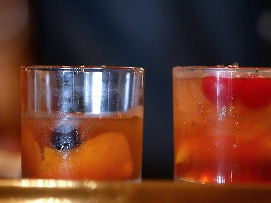 A classic-style Old Fashioned and a Wisconsin-style Old Fashioned are two cocktails available at The Libertine in downtown Green Bay.
