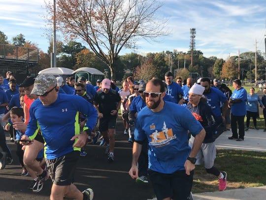 Runners start off the Teaneck 5K Walk/Run for Children's