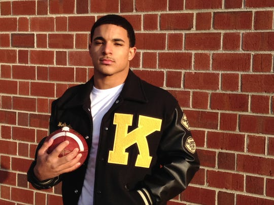 Former Kenwood quarterback Malcolm Perry ran for more