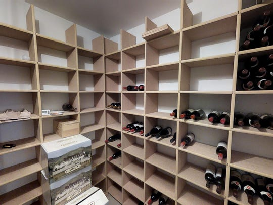 The wine cellar is one feature of the home at 7911 North Shore Drive, Spicer.