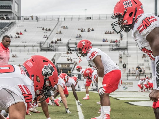 Austin Peay football warms up for a game against Central