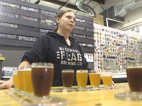 Owner Torie Fisher serves up some beer flights at Backward Flag Brewing Company in Forked River