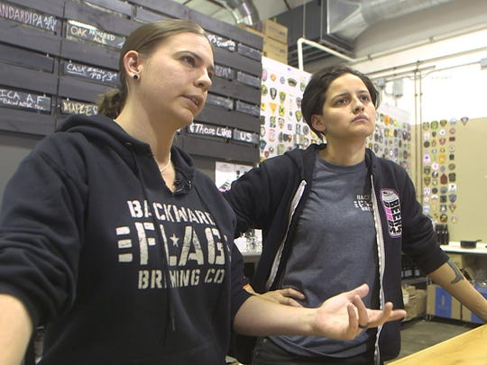 Owner, Torie Fisher and head brewer Melinda Gulsever talk craft beer at Backward Flag Brewing Company in Forked River