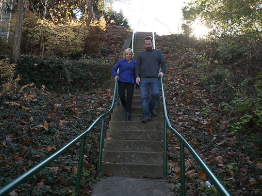 Kirby and Kevin walk down the chicken steps leading to Frankfort Ave