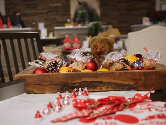 All you need is a Childs toy surrounded by festive goodies to create the perfect holiday snack table