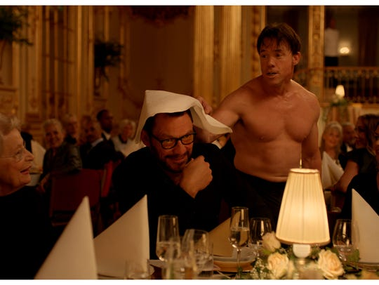 """Dominic West and Terry Notary, center, in """"The Square,"""""""