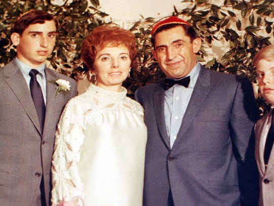 Paul Sass poses for a family photo with his wife Bernice and sons David (left) and Harvey (right), shortly before his murder on 6/6/69.
