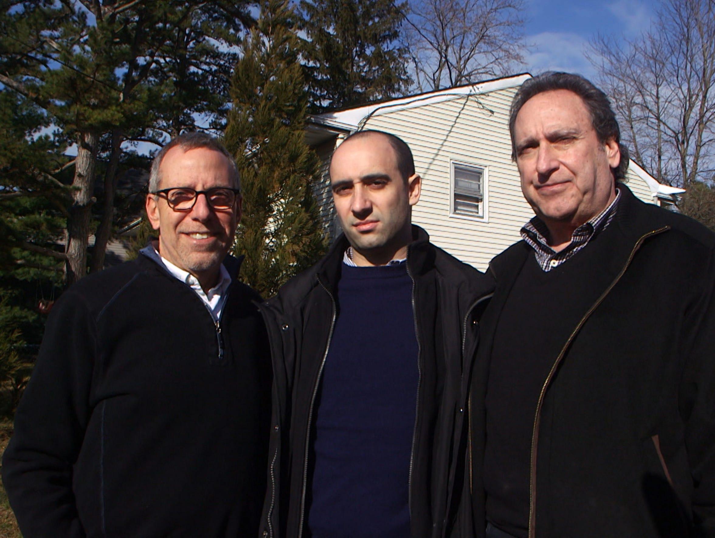 Brothers Harvey and David Sass pose with David's son